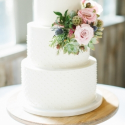 Buttercream wedding cake with swiss dots