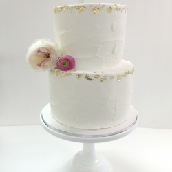 Textured buttercream with gold leaf