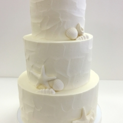 Buttercream cake with edible shells